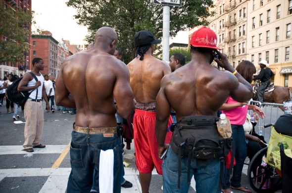 Muscular bare backs; three men