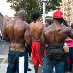Muscular bare backs; three men