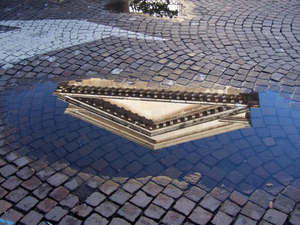 Reflection; Pediment; cobbled street; Italy