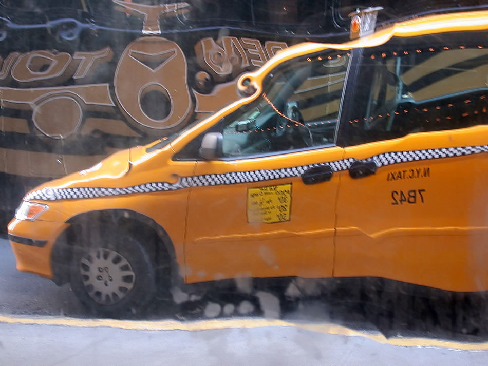 Yellow taxi cab reflections, New York City, 2006