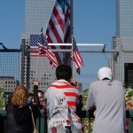 People reflect, remember at 9/11 Ground Zero, anniversary service, Manhattan, 2003