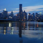 Manhattan skyline, buildings and lights in river water, New York 2006
