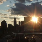 Sun flare at sunset over Manhattan skyline, New York 2006