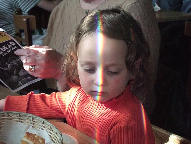 Rainbow face, little girl at La Rosita Restaurant 2006