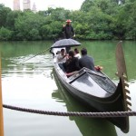 Gondalier with passengers on Boathouse lake, Central Park, New York, 2008