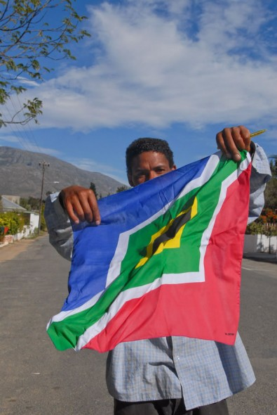 Man wears South African flag, Barrydale, 2008
