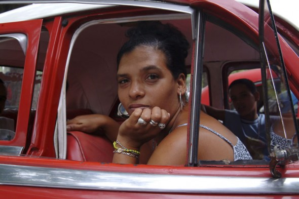 Portrait of beautiful Cuban lady in a taxi, Havana, Cuba, 2004