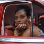 Portrait of beautiful Cuban lady in a taxi, Havana, Cuba, 2004