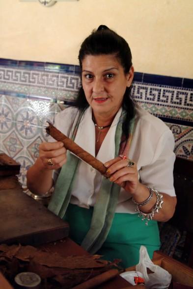 Woman makes cigars in hotel, Havana, Cuba, 2004