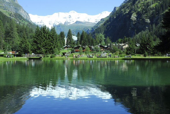 Gorgeous lake with snow topped mountains, trees and relfections, Gressoney, Italy, 2006