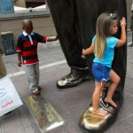 Libby-Jean and little boy at feet of Nelson Mandela statue, Mandela Square, Johannesberg 2008