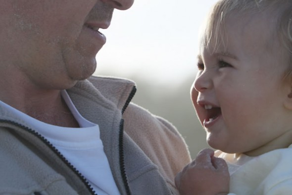 Little girl, Ella, shares special smile with dad when walking on the Noordhoek Beach