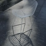 Wire chair and shadow, in sunlight, New York, 2008
