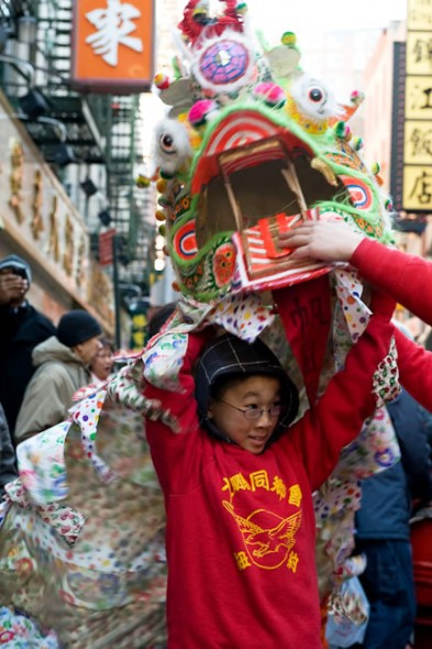 Girl puts on Lion Dance costume in 2009 Chinese New Year celebration in New York Year of OX, Chinatown