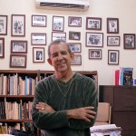 Miguel Cabrera, in his office, wrote book Ballet Nacional de Cuba: Medio Siglo de Gloria, 2004