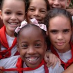 Bright smiling faces of schoolchildren in uniform, Havana, 2006