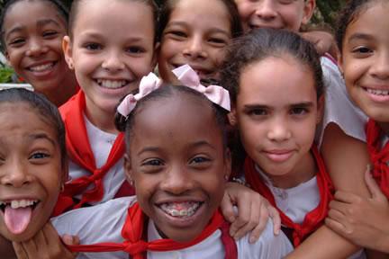 Bright smiling faces of schoolchildren in uniform, Havana, 2006