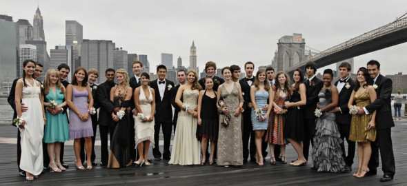 Glamorous couples before High School Prom at Brooklyn Bridge, New York skyline