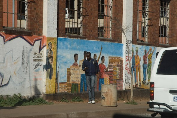 Man with Figure People Mural, Johannesburg, 2008