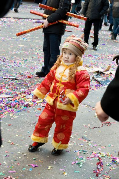 Child in Mandarin outfit Chinese New Year parade, Chinatown, New York, 2009