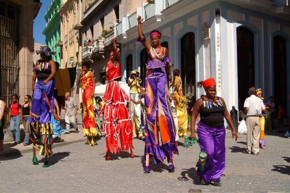 SStreet entertainers in bright costumes and stilts, a la mardi gras, Havana, Cuba, 2006